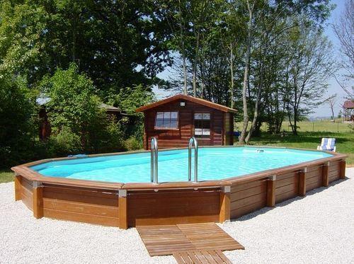 CARON PISCINES - Pool mit Holzumrandung-CARON PISCINES-Hors-sol grand modèle